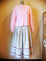 Pink_Cardigan_and_White_Tyrol_Skirt.png